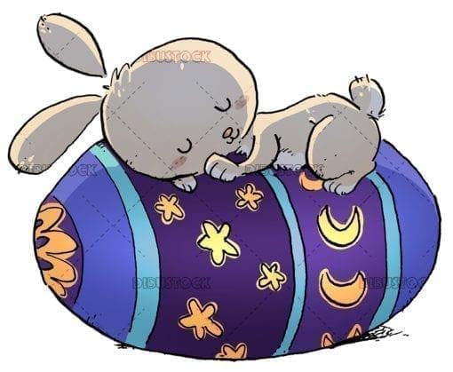Easter bunny sleeping with egg