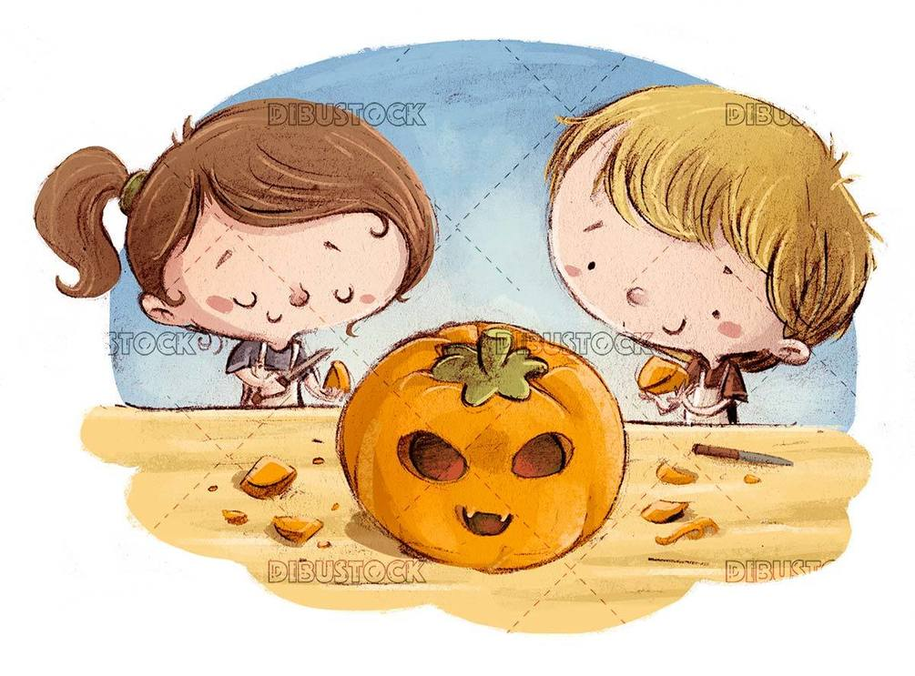 kids preparing a halloween pumpkin at the table