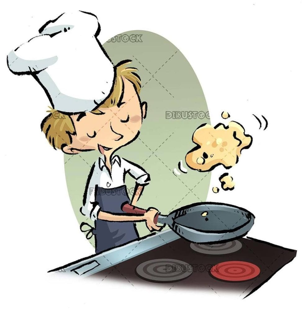 Young man cooking an omelet with the pan