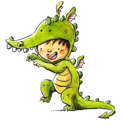 little boy dressed as a green dragon