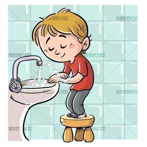 boy washing his hands with soap