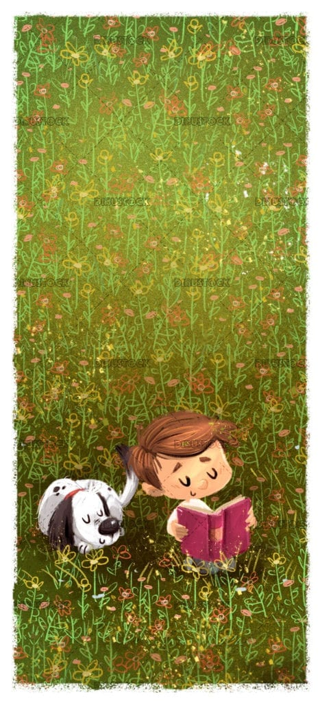 Happy child with dog reading in the field a book