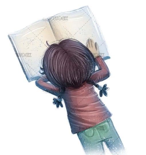 Little girl lying down reading