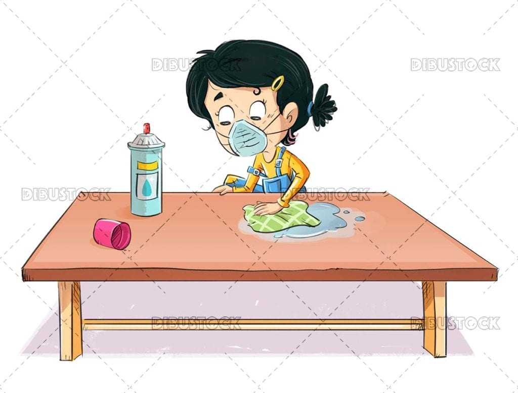 Little girl cleaning the table